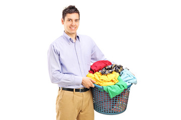 Young man holding a laundry basket