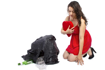young woman cleaning and finding an old valentine's gift