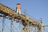 Workers Fabricate Formwork and Reinforcement Bar poster