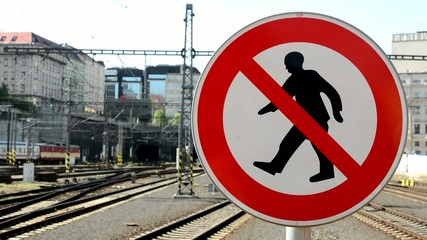 sign: no entry, train station in the background
