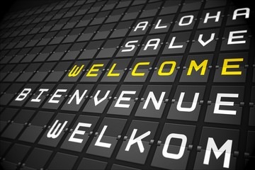 Welcome in languages on black mechanical board