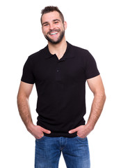 Young happy man in a black polo shirt
