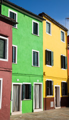 Green and Yellow Homes in Burano