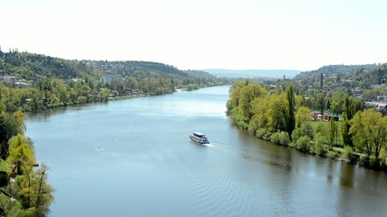 boats on the river Vltava with the city and nature