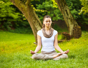 Young female meditate in nature