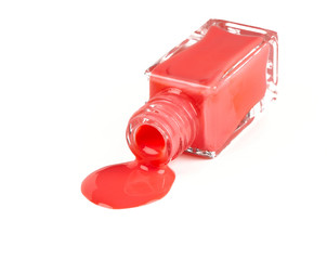 pink polish bottle spilled over white background