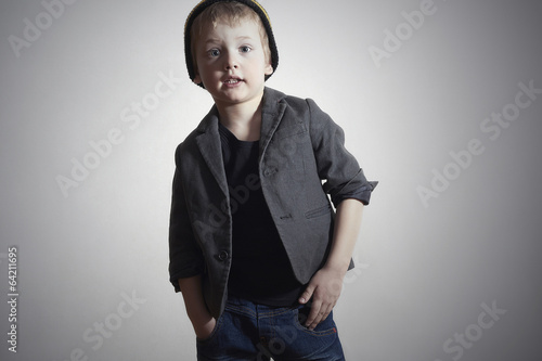 Funny little Boy.grunge cap and jeans.Fashion Children