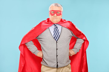 Mature superhero on blue background