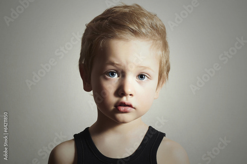 Child. Funny Little Boy. Handsome Kid with Blue Eyes.Children