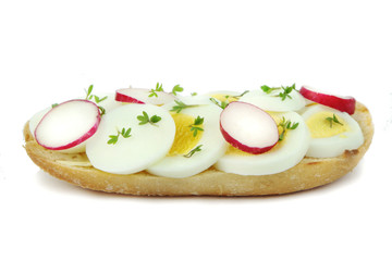 Sandwich with egg, radish and cress, close up image