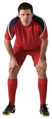 Tired football player bending over