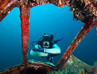 Diver looking into cabin of plane wreck