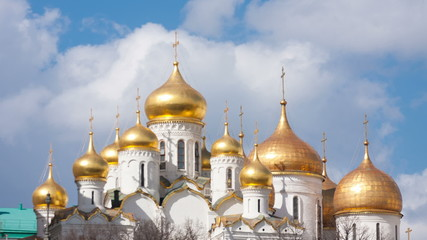 Clouds over gold domes of Annunciation Cathedral in the Moscow K