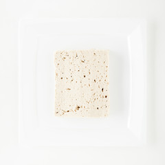 Tofu on White Dish on White Background