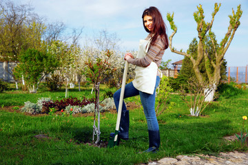 Woman working with shovel on the garden outdoor