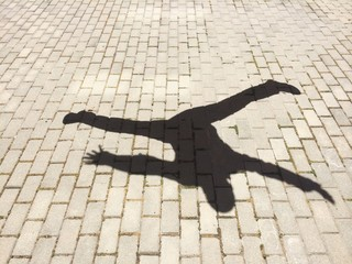 The shadow of a happy man jumping
