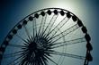ferris wheel silhouette by moonlight