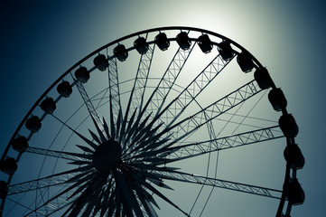 ferris wheel silhouette by moonlight
