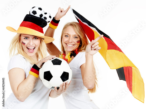 Two girly soccer fans celebrate the victory - 64216445