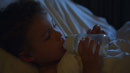Boy drinking milk before bedtime