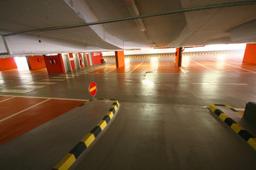 Empty parking garage with arrow for left or straight ahead