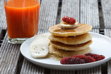 Stack of delicious pancakes with fresh fruits