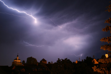 Lightning in a storm in old medival city (Kamnik, Slovenia)