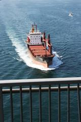 Transport ship crossing under Bosphorus Bridge in Istanbul