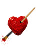 Red color painted heart pierced by paintbrush