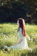 girl sitting on a meadow