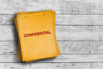 Confidential stmp on yellow envelope