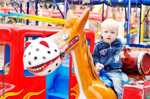 boy in the amusement park