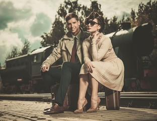Vintage couple on train station platform