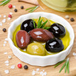 assorted olives in olive oil, top view