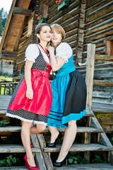Austrian Woman standing by a wooden Hut