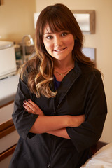 Portrait Of Female Beautician In Clinic