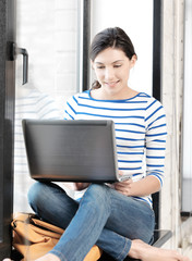 happy teenage girl with laptop computer