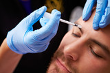 Man Having Cosmetic Injection Treatment at Beauty Clinic - 64229210