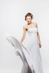beautiful slender bride in an elegant dress