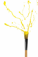 Yellow paint bursting out of paintbrush