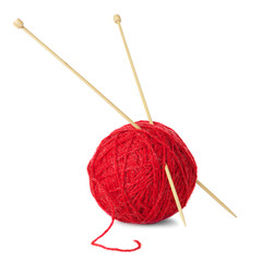 Red ball of wool and knitting needles isolated on white backgrou