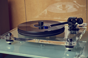 Modern expensive vinyl turntable playing music.