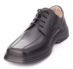 Black glossy man's shoe with shoelaces