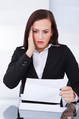 Shocked Businesswoman Reading Document