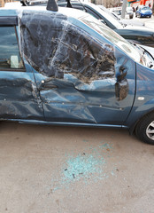 broken window of car during road accident