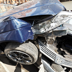 broken hoods of cars during road accident