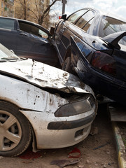 three broken cars during road accident
