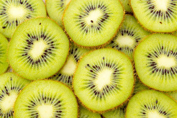 Healthy food background with beautiful green kiwi