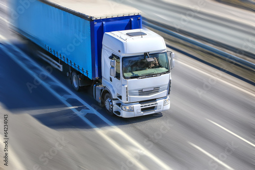 truck moves on highway poster