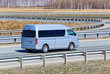 motor van goes on the highway - 64234252